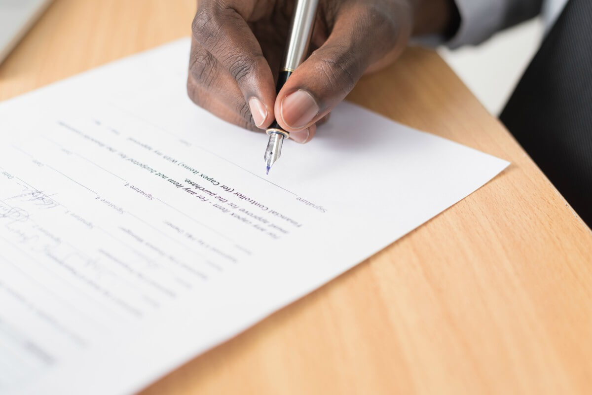 Your House Search Checklist - man signing contract