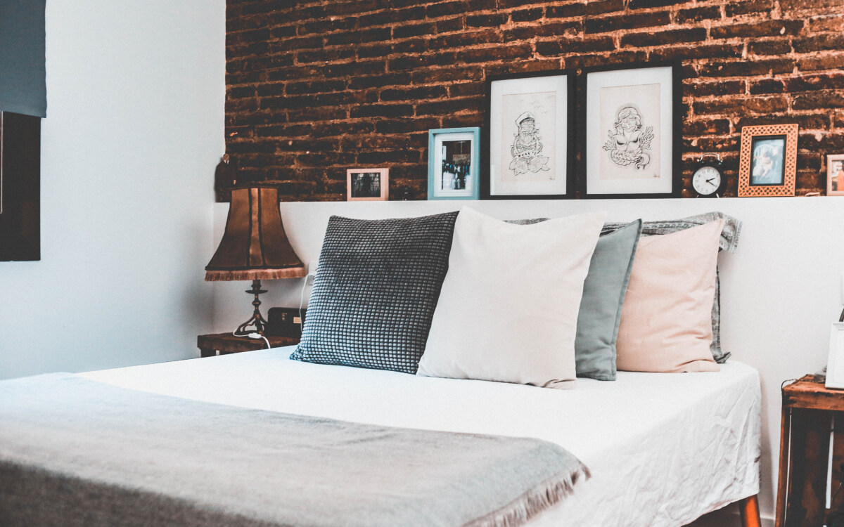 guest bedroom with brick wall